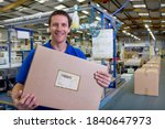 A Happy Worker Holding And...