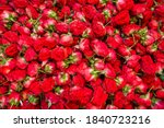 Small photo of Red roses for sale at and indian market. Fresh red roses heads cloe up background