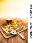 pizza on the wooden table   Shutterstock . vector #184086158