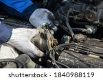 Small photo of Check engine ignition system and change ignition coil. Car care service. Replacing ignition coil and spark plugs. Car mechanic fixing ignition coil on gasoline, cylinder combustion engine.