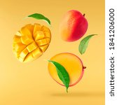 Small photo of Fresh ripe mango with leaves falling in the air isolated on yellow background. Food levitation concept. High resolution image