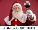 Claus Holding A Glass Of Wine...
