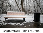 Bench Under The Snow In A City...
