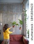 Woman Holding Macrame Plant...