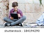 Attractive Teenager Boy Sitting ...