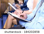 hands holding pens and making... | Shutterstock . vector #184202858