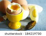 Boiled Eggs On Color Wooden...