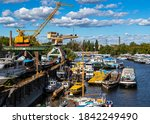 Small photo of Budapest Hungary Oct. 24, 2020: Old shipyard and boats. Dismounting dock. Vintage river cruisers and pleasure craft are maintained and dismounted here.