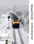 Small photo of CHIPPENHAM, UK - JANUARY 9, 2009: A First Great Western HST 125 (Intercity 125 train) arrives at Chippenham station as winter storms cross the UK.