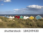 beach huts against a blue sky...