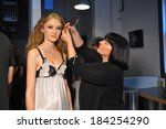 Small photo of LOS ANGELES, CA - MARCH 15: A model gets ready backstage before Aenas Erlking Fashion Presentation during Concept LA Fashion Week Fall 2014 at Mack Sennett Studios on March 15, 2014 in Los Angeles.