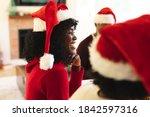 Portrait Of Woman Wearing Santa ...