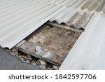 Old Damaged Asbestos Cement...