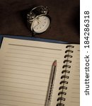 Note Pad With Pen And Clock On...