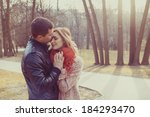 young happy couple hugging in... | Shutterstock . vector #184293470