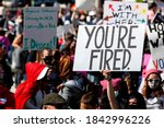 "Small photo of Washington, DC, USA - October 17, 2020: One of the signs carried by protesters at the Women's March said simply, ""You're Fired,"" a reference to Donald Trump's previous job as a reality TV host"