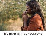 girl closed her eyes  praying...