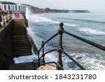 Waves Crash Into The Steps And...