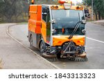 A Small Street Sweeper With Two ...