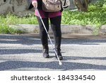 close up in blind woman's feet... | Shutterstock . vector #184334540