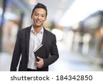 young asian business man... | Shutterstock . vector #184342850