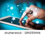 finger pointing on tablet pc ... | Shutterstock . vector #184350446