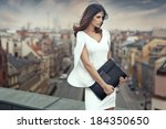 smart businesswoman on the roof ... | Shutterstock . vector #184350650