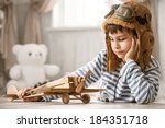 little boy plays with wooden... | Shutterstock . vector #184351718