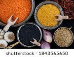 Various of organic lentils on the wooden table. Dried lentils and legumes concept in the bowl