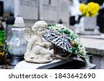White Angel Figurine And Grave...