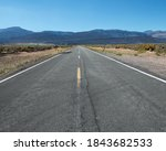 Small photo of Blacktop Straightaway Road across the High Desert. Washoe County Route 447 through Reederville, Nevada, USA. Aka Gerlach-Cedarville Road.
