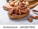 Small photo of Pecan nut unshelled. Pecans are rich in various trace elements and vitamins