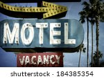 neon motel sign with palm trees | Shutterstock . vector #184385354