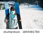 Female Skier Posing With A Pait ...