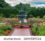 Fountain And Flowers In The...