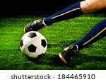 soccer player feet with ball... | Shutterstock . vector #184465910