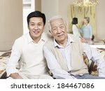 home portrait of asian father... | Shutterstock . vector #184467086