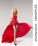 beauty blond woman in red dress | Shutterstock . vector #184469120