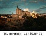 Alcazar of Segovia at night as the famous landmark in Spain.