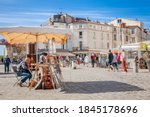 Small photo of LA ROCHELLE, FRANCE - 8 SEP 2019: Street artist on the waterfront of the old port of La Rochelle.