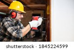 Carpenter Worker At Work With...