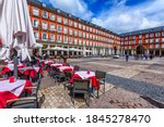 Small photo of Plaza Mayor in Madrid, Spain. Plaza Mayor is a central plaza in the city of Madrid. Architecture and landmark of Madrid