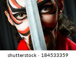 man with sword and face mask   Shutterstock . vector #184533359