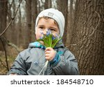 little boy smelling the aroma... | Shutterstock . vector #184548710