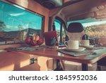 Camping Time Inside Comfortable Motorhome Interior. Stylish Self Made Camper Van Interior. Van Conversion Theme. - stock photo