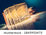 Two Hundred Bills Euro Banknotes on Glassy Table. European Banking System and Economy Theme. - stock photo