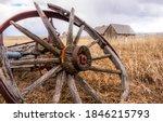 Old Broken Wagon Wheel In Farm...