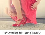 woman and red skirt  | Shutterstock . vector #184643390