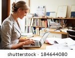 female architect working at... | Shutterstock . vector #184644080