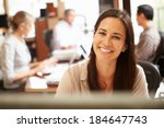 businesswoman working at desk... | Shutterstock . vector #184647743